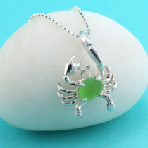 "Also known as the elusive ""spider of the sea,"" the Crab is a popular symbol representing self protection and security. It is also the Zodiac character for the period, June 22 - July 22. There is nothing more appealing than this this sterling silver, rare turquoise green sea glass crab pendant that comes with a beautiful sterling silver necklace in your choice of lengths. Be the first to wear this one of a kind design or gift it to someone you love who has a strong imagination, and is romantic, loving and affectionate. Order today and we will provide free, premium gift wrap, free priority shipping and a $$ back guarantee if you are not thrilled with your purchase! Metal: Sterling Silver Necklace and Crab Origin of Sea Glass: Nova Scotia Rarity: Turquoise/Green is Extremely Rare Birthstone Equivalent:Turquoise/Green=Emerald, the May Birthstone Size of Sea Glass: Small, @1/2"" x 1/4"" Size of Crab Pendant: Small: 1-1/8"" Long, 3/4"" Wide [cc_product sku=""n682"" display=""inline"" quantity=""true"" price=""true""] View More Turquoise Sea Glass Jewelry Here!"